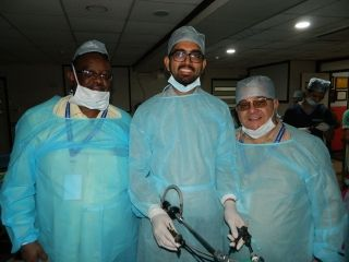 Gynecologist practicing Laparoscopic Burch Colposuspension for stress urinary incontinence and Sacrohysteropexy for uterine prolapse on the Live Tissue Demonstration by Dr. J. S. Chowhan.