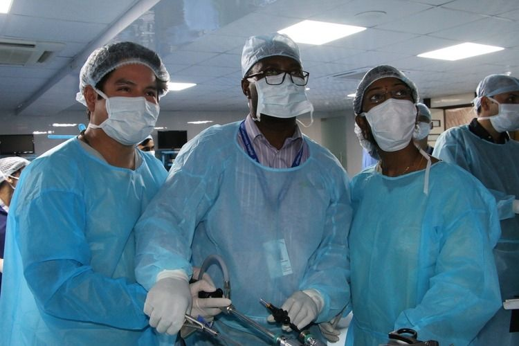 Surgeons performing Laparoscopic (TAPP) Trans Abdominal Preperitoneal Inguinal Hernia repair on the Live Tissue.