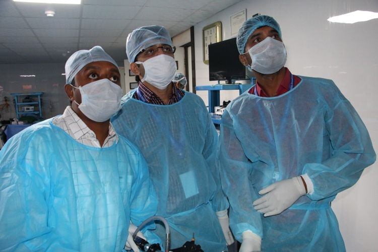 Hands on Training in Minimal access surgery Surgeons Practicing Laparoscopic Nissen Fundoplication, Nephrectomy and Splenectomy surgery on the live Tissue.