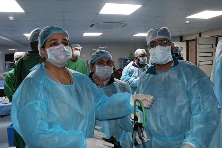 Surgeons performing TAPP Trans Abdominal Pre Peritoneal Inguinal Hernia repair and injury associated with non-accidental blunt abdominal trauma (Duodenal perforation) on the Live Tissue.