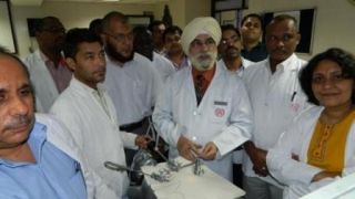Surgeon & Gynecologist practicing Laparoscopic Square knot Demonstration by Dr. J . S Chowhan