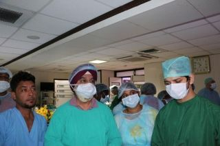 Gynecologist Performing Sacrocolpopexy, Burch Suspension and Lymphadenectomy.