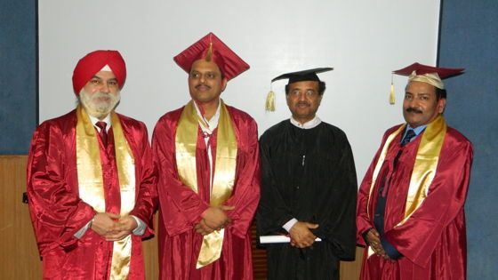 Dr. Sujan Sen receiving