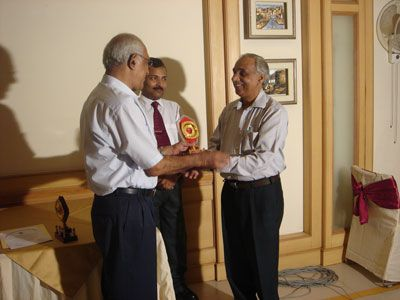 Mr. H.L. Atri receiving Guest of Honor Memento from Dr. Gorantla Lakshmi Naryana (Topper of the Batch) in Farewell Party.